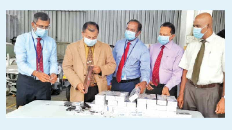Customs Director General  Major General (Retired)  G. V. Ravipriya, and Senior Customs Officials inspecting the consignment.