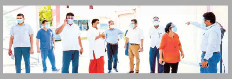 State Minister Piyal Nishantha de Silva and others at the temporary COVID-19 treatment centre.  Picture by H.L. Sunil Shantha, Kalutara Central Special Corr.