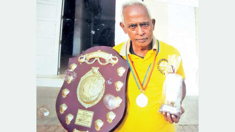 N. L. W. Narasinghe with his Trophies. Pic by Upananda Jayasundera, Kandy Sports Special Corr