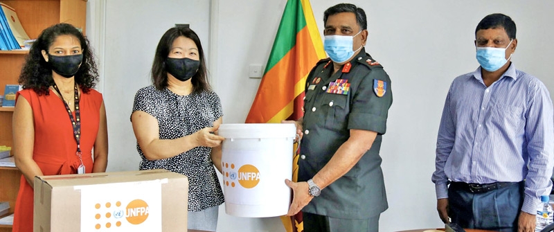UNFPA Country Representative Ritsu Nacken making a token presentation of the donation to Disaster Management Centre (DMC) Director General Maj. Gen. S.Ranasinghe. J.M.S.Jayaweera - Director (Preparedness Planning), DMC and Sharika Cooray, National Programme and Policy Analyst - Women's Rights & Gender of the UNFPA were also present.