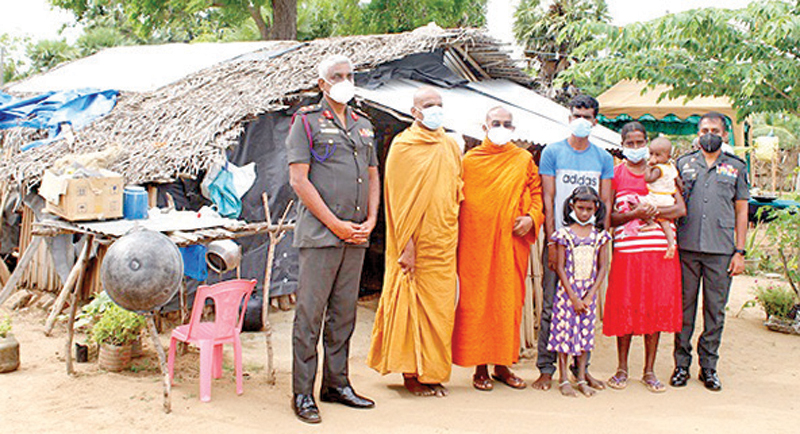 The family along with two members of the Maha Sangha and Army Officers.