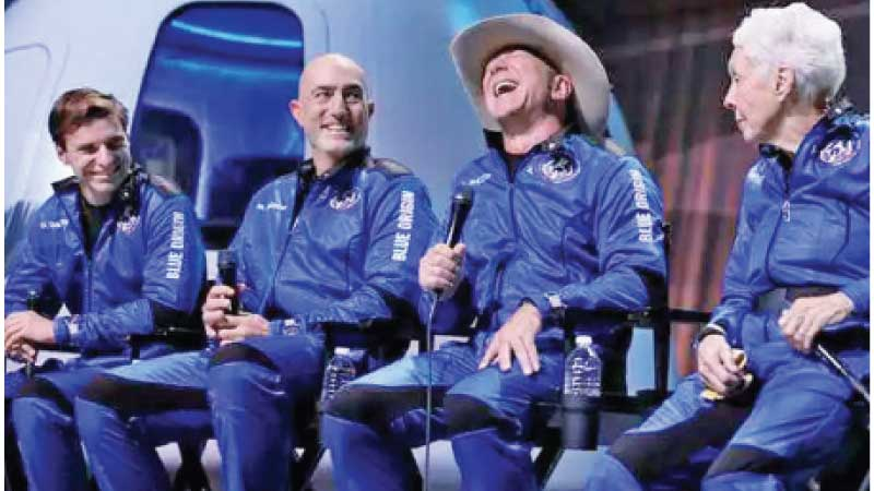 Blue Origin's New Shepard crew (L-R) Oliver Daemen, Mark Bezos, Jeff Bezos and Wally Funk speaking at a press conference after their suborbital flight into space on Tuesday.
