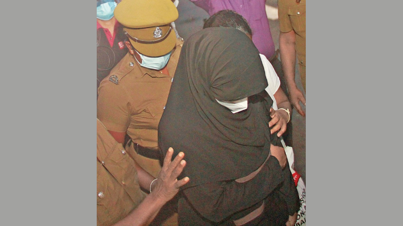 MP Rishad Bathiudeen's wife in court yesterday.  Picture by Dushmantha Mayadunne.