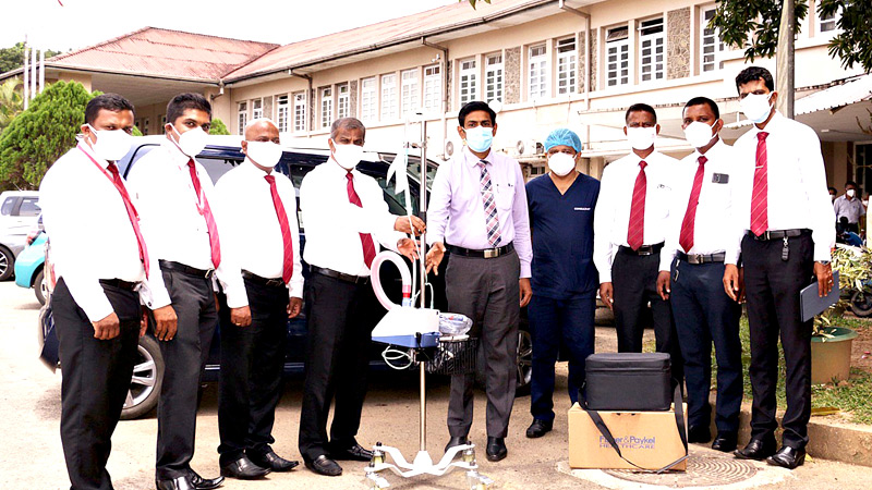 Representatives of Ceylinco Life and the Teaching Hospital Ratnapura at the presentation of the equipment. Ceylinco Life's Head of Branch Ratnapura 06, I.M.A.S. Bandara, Assistant Regional Sales Manager Buddhika Wickramasinghe, Manager Business Development Thushara Bandara, General Manager Business Development Joe Jayawardhana, Hospital Director Dr Anoja Rodrigo and Consultant ENT Surgeon Dr Madhawika Dayarathna, Ceylinco Life's Agency Supervisor Annesly Rohitha, Head of Branch Ratnapura 02, Chinthaka Rohan