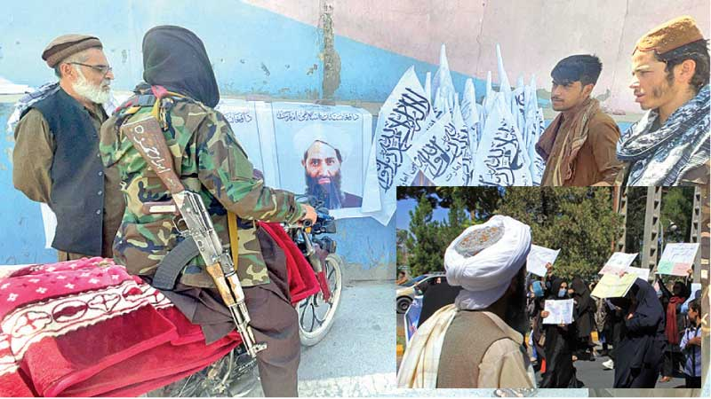 Taliban members stand near a poster of their Supreme Leader MullahHibatullah Akhundzada in Kabul.-A member of the Taliban watches as Afghan women hold placards during a protest in Herat on Thursday.