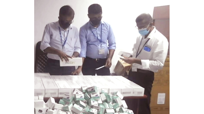 NMRA officers inspecting the unregistered items.