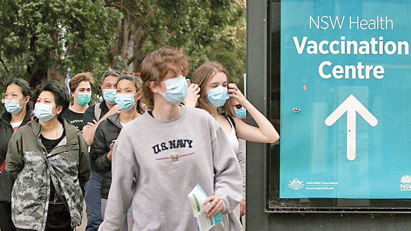 People walk past a vaccination centre in New South Wales