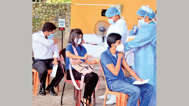 Youths aged 20-30 line up for Covid-19 vaccination at the Vihara Maha Devi Park yesterday. (Picture by Ranjith Asanka)