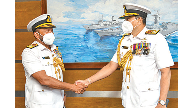 Navy Commander  Vice Admiral Nishantha Ulugetenne bidding adieu to Rear Admiral Marcus Perera on his retirement from the Naval service.