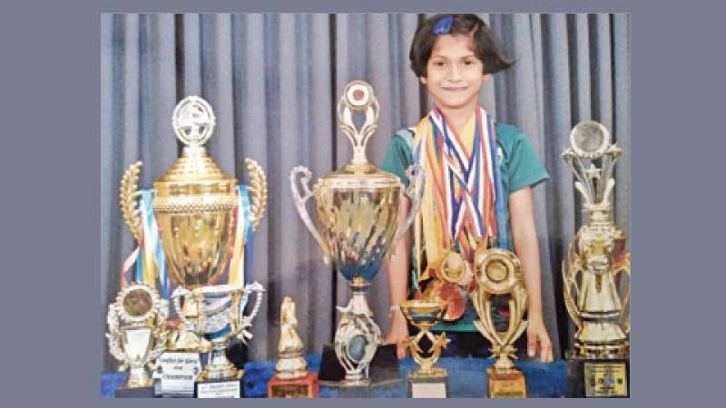 Oshini Gunawardena with her medals and trophies