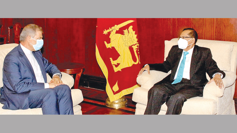 Foreign Minister Prof. G.L. Peiris in discussion with Ambassador of the Islamic Republic of Iran Hashem Ashjazadeh.