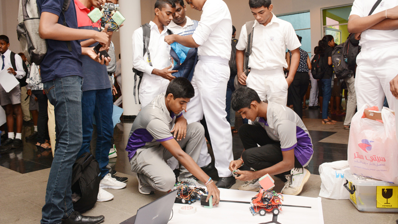 A group of students developing robots at the program