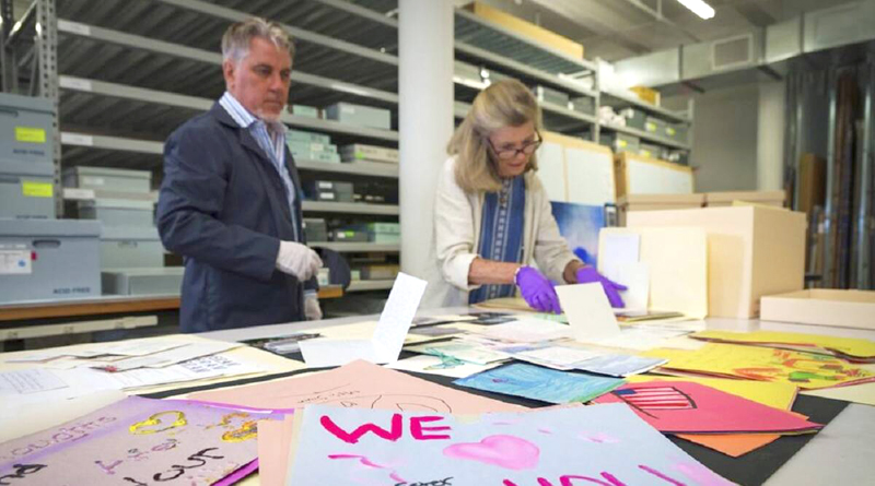 Jan Ramirez, chief curator at the 9/11 Memorial and Museum, right, sifts through a collection of condolence cards for victims of 9/11 that were donated to the museum's archive.