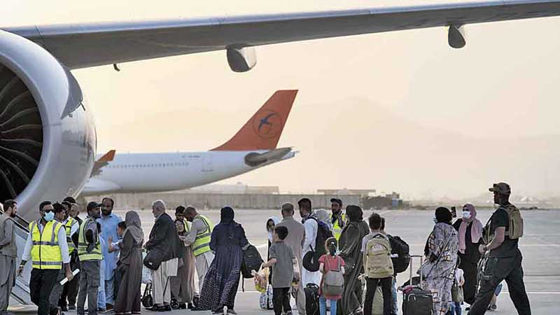 Foreigners board a Qatar Airways aircraft at Kabul airport on Thursday. - PTI