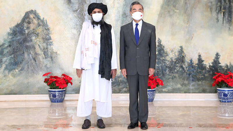Chinese Foreign Minister Wang Yi with a senior Taliban representative