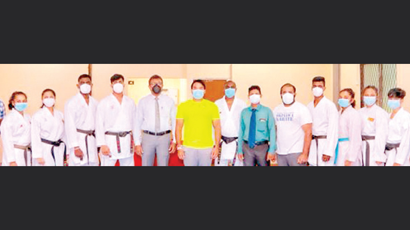 Sports Minister Namal Rajapaksa and Director General Amal Edirisooriya with Karate Association officials and players at the new Training center at Torrignton Sports Complex.