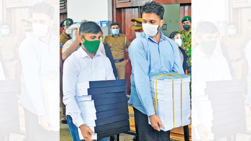 Documents related to the trial and suspects accused over the Easter Sunday terror attacks being brought to the Colombo High Court yesterday. Picture by Ranjith Asanka