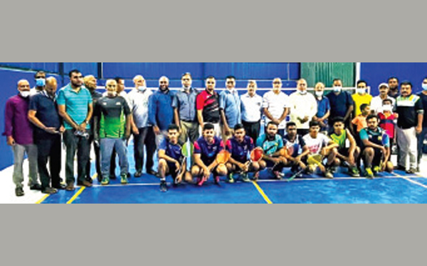 Badminton players and officials