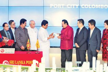 Prime Minister Mahinda Rajapaksa, Minister of Information & Communications Technology, Higher Education, Technology & Innovations, Bandula Gunawardane, Chinese Ambassador to Sri Lanka Cheng at the commemorative stamp and first day cover issue event. Picture by Shan Rambukwella