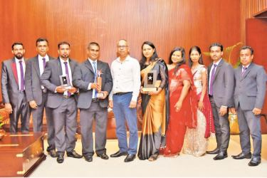 Ellawala Horticulture(Pvt) Ltd, officials with the awards