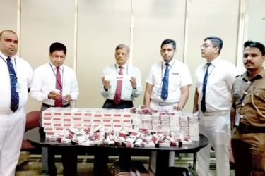 BIA Customs officers with the haul of cigarettes that was seized.