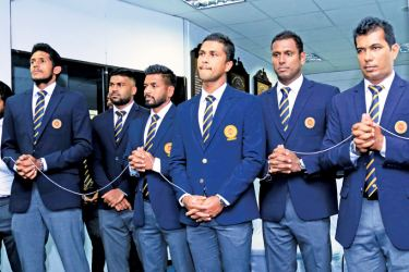 The Sri Lanka cricket team takes part in a religious ceremony at SLC headquarters prior to their departure to Pakistan yesterday.