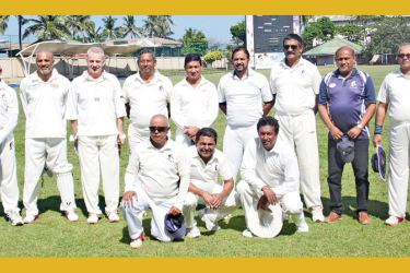 The winning Colombo Masters cricket team after the match played at S. Thomas' College, Mount Lavinia grounds.
