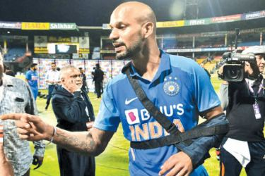 Shikhar Dhawan picked up his injury during the victorious third ODI with Australia. - AFP