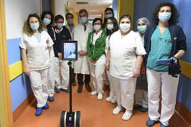 Italian doctors and nurses pose with a medical robot (afp pix)