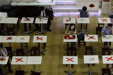 A food outlet in Singapore placed markers on selected tables to separate diners