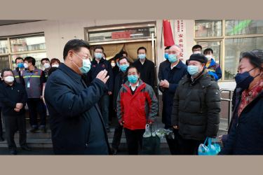 Chinese President Xi Jinping talks to residents