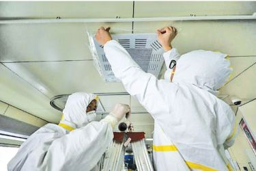 Experts say better ventilation and air filters in buildings may be needed to ward off coronavirus infection via airborne droplets.