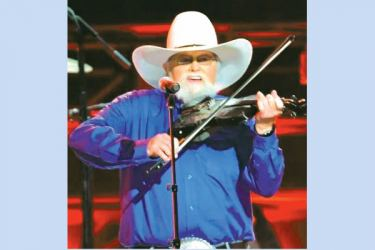 Country music firebrand Charlie Daniels playing his trademark fiddle.