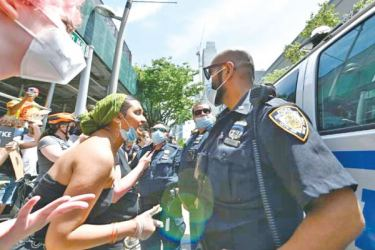 A protesters arguing with a Policeman at a recent anti-gun rally in Brooklyn, New York.