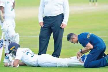 Dinesh Chandimal being treated in the field.