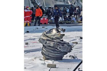 A piece of wreckage recovered at sea from the Boeing 737-500 is pictured at Tanjung Priok port, north of Jakarta yesterday, after Sriwijaya Air flight SJ182 crashed into the Java Sea minutes after takeoff on January 9. - AFP