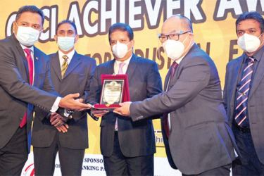 Managing Director of Ocean Lanka, Dr. Austin Au and Management Team with the CNCI National Merit Award from Minister of Industries Wimal Weerawansa