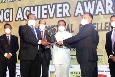 Pussalla Chairman, Philip J Wewita and Managing Director, Dilshan J Wewita receive the top ten award from Minister of Industries Wimal Weerawansa at CNCI achievers awards 2020. Pictures by Saliya Ruapsinghe.