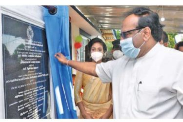 Minister Sarath Weerasekera opening the new office.