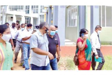 State Minister Kanaka Herath along with State Minister Sita Arabepola inspecting the site for the first City University in Wagolla.