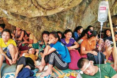 Villages injured during air strikes are seen while taking shelter in a jungle in Myanmar's Kayin state, on Tuesday.