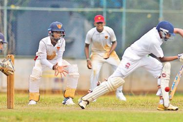 Action from an Inter-Schools U-19 cricket match.  Picture by Hirantha Gunathilaka