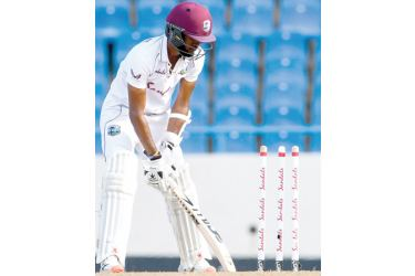 Kraigg Brathwaite of West Indies bowled by Dushmantha Chameera of Sri Lanka (out of frame) during day 4 of the second Test. - AFP