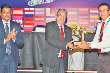 Rohitha Jayatilake General Manager Inland Container Terminal of Spectra Integrated Logistics with the two awards