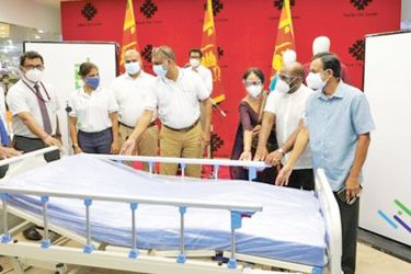 SLT-MOBITEL officials hands over newly equipped ICU Bed to Kandy General Hospital, accompanied by Thusitha Wijesena, Chairman of Kandy City Centre