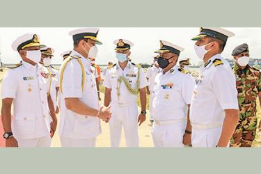 Navy Commander Vice Admiral Nishantha Ulugetenne conversing with the Commanding Officers of the Indian ships before the ceremony.