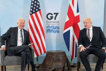 Britain's Prime Minister Boris Johnson speaks with U.S. President Joe Biden during their meeting, ahead of the G7 summit, at Carbis Bay Hotel, on June 10, 2021 near St Ives, England.