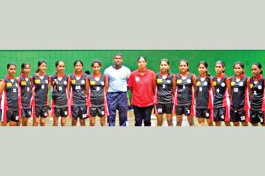 Sri Jayawardenapura University were the All Island Champions of the 2014 Inter University Volleyball Tournament and Pramodi Madushani is standing ninth from left in the photograph. The coach Mr. Omal standing seventh from left and standing eighth from left is Mrs. Ramani Gunathilake the teachers incCharge of volleyball. (Dilwin Mendis, Moratuwa Sports Special Correspondent)