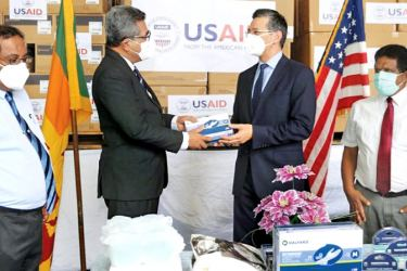 U.S. Embassy Charge d'Affaires Martin Kelly handing over the donation to Health Ministry Secretary Dr. S.H. Munasinghe.