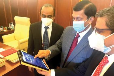 State Minister of Money & Capital Market and State Enterprise Ajith Nivard Cabraal re-launching PLC corporate Trilingual Website. Sujeewa Rajapakse, Chairman Sujeewa Rajapakse (L) and Chief Executive Officer /General Manager Shamindra Marcelline (R) of People's Leasing & Finance PLC look on